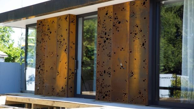 The Martins chose to clad part of the house with Corten steel, which develops a rust patina.