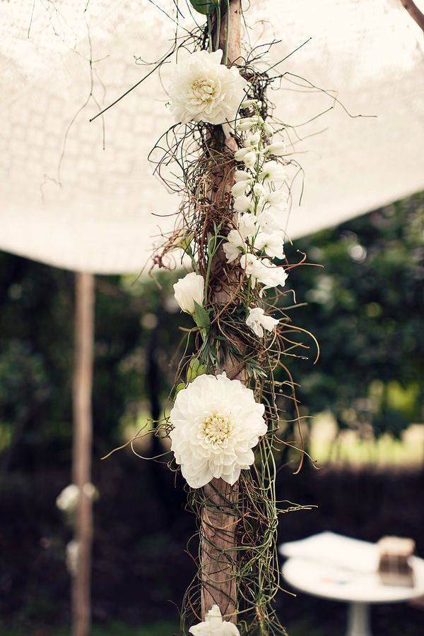 flowers and wine twisted around tent poles