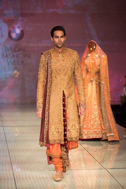 Tarun Tahiliani ornate gold men's shervani kurta. More here: http://www.indianweddingsite.com/bmw-india-bridal-fashion-week-ibfw-2014-tarun-tahiliani-show/