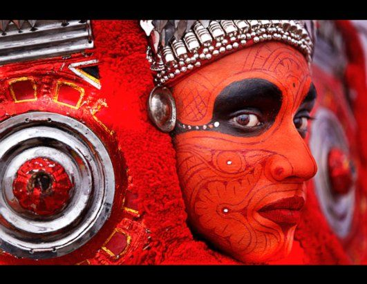 A Theyyam dancer gets ready for Onam Celebrations at Kerala Bhawan in New Delhi, India, Sept. 16, 2013. Theyyam or Theyyattam is popular folk dance performed in the North Malabar region of Kerala