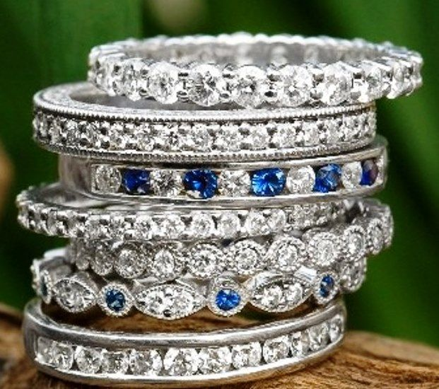 Diamond and sapphire rings ~ love the idea of having a few of your husbands birthstones in your wedding band