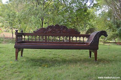 #ClassicFurniture : Diwan with #yali carved back and side-rests. Best-suited for living rooms with the classic touch to its #interiors.  www.madhurya.com