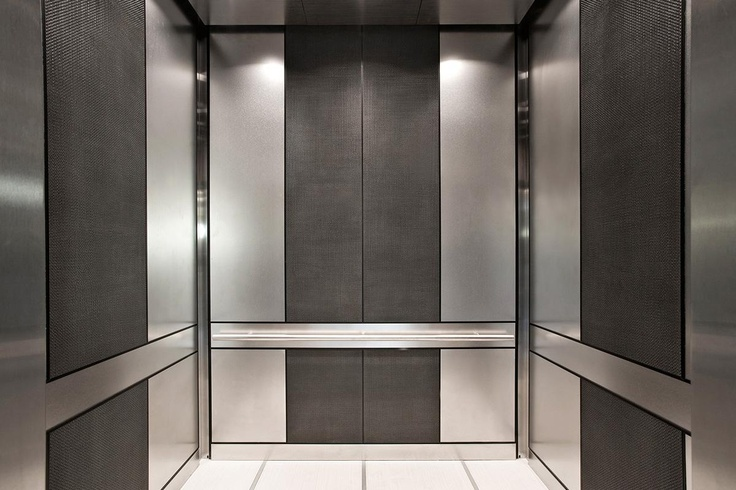 Levele 105 Elevator Interior With Main Panels In Stainless Steel With Sandstone Finish Accent