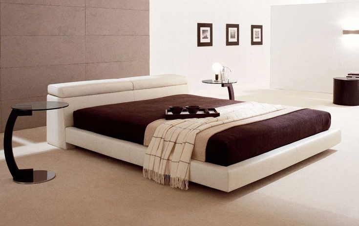 Modern bed with some pretty cool bedstands