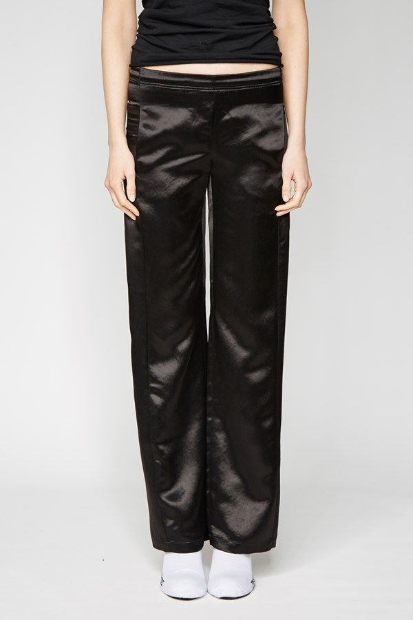the zambesi PJ'S in black satin. - made in new zealand. - loose fit pj style pants - pull on elasticated waist - displaced side seams down front legs with pockets