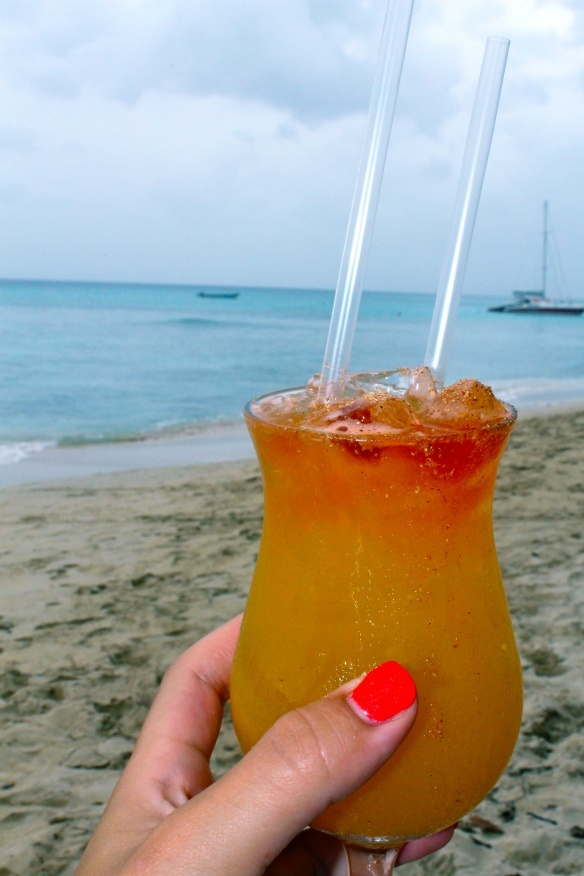 Bajan Rum Punch on the beach in #Barbados, Cheers! We can mix one up for you at Yellow Bird Hotel too.