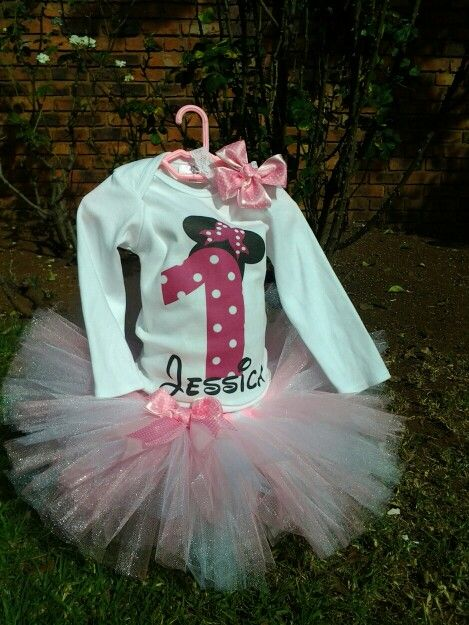 Baby pink and white tutu paired with a printed long sleeve onesie, and stretch lace headband with big satin bow.