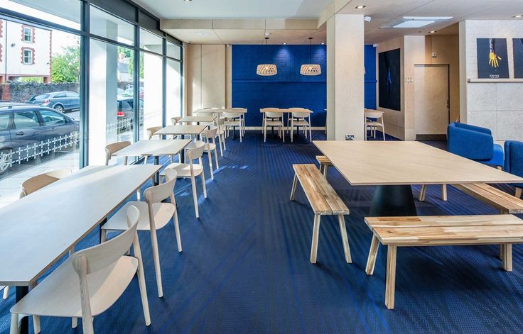 Blue striped flooring from the Bolon By You collection at the KIN + ILK café in…