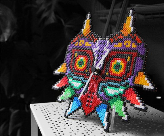 This one doesnt have a time limit of three days!    This listing is for a totally hamdmade Majoras Mask Clock made of fused plastic beads with a