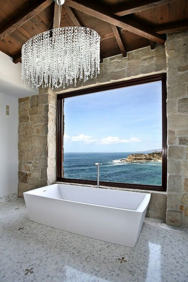 Mediterranean style bathroom with ocean view [Design: Ancient Surfaces]