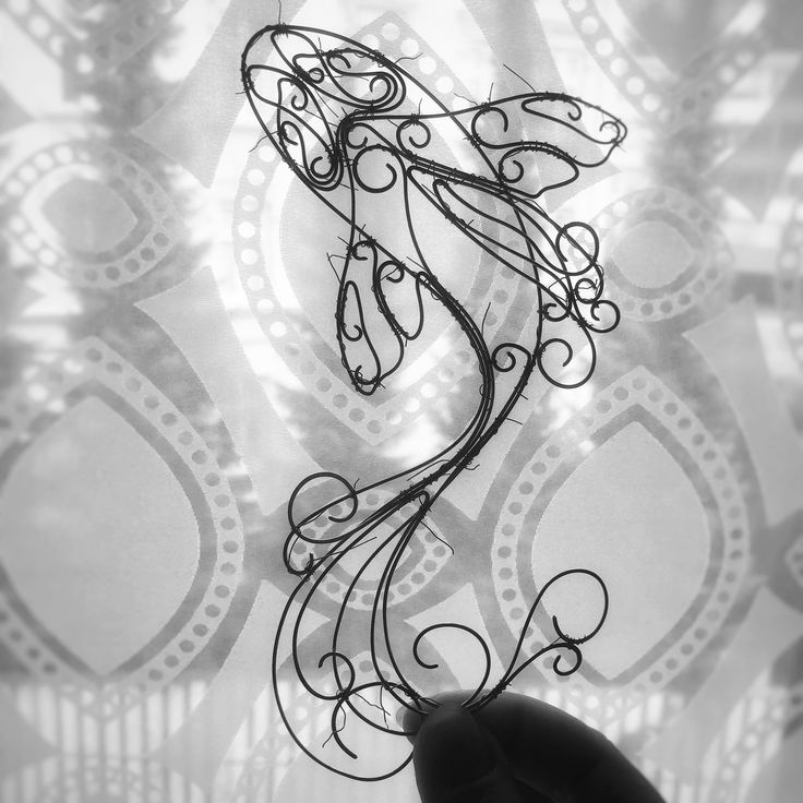 Wire art - koi fish in the process of making  Instagram @springstring
