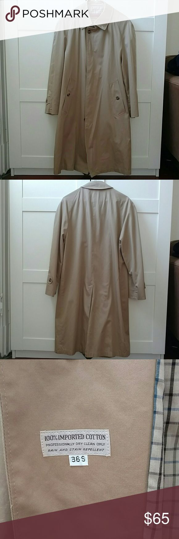 Classic khaki colored cotton rain overcoat 36S This vintage Gleneagles rain overcoat is 100% cotton with a cotton lining.  It has two exterior pockets and one pocket in the lining.  It is in great vintage condition with even the spare buttons intact.  There is one small light spot as indicated in the photo.  Men's size 36 S Vintage Jackets & Coats Trench Coats