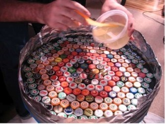 bottle cap table... Have had my staff save caps from all the beer we have sold I have bags and bags of craft beer caps.. Now to craft with them !!