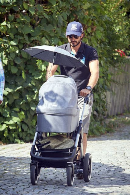 Prince Carl Philip of Sweden strolling his son Prince Alexander while the…