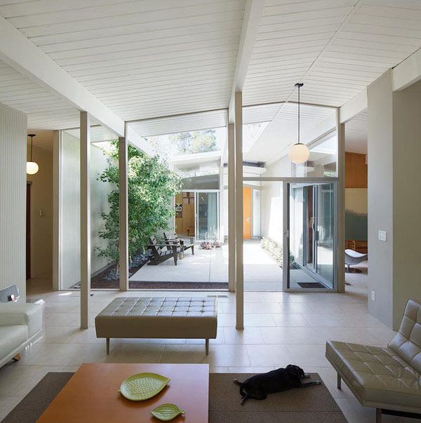 Mid century modern captured by David Lauer-- white beams ceiling, floor, hanging light