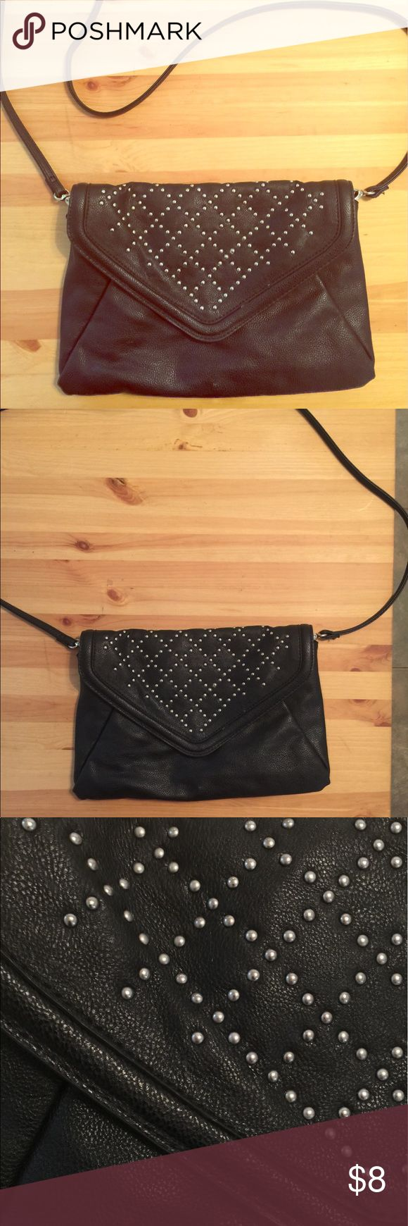 Steve madden purse Steve madden /edgy/ black / it has signs of wear mostly in the inside of the purse. Bags Crossbody Bags