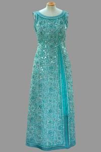 Pale blue shift with all over beading in floral design    Norman Hartnell    First worn by Queen Elizabeth II for a State Dinner in Toronto, during the Official Visit to Canada from June to July 1973.