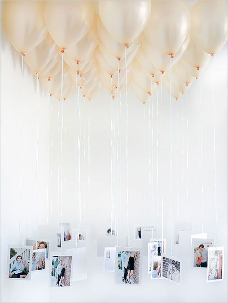 Rather than framing pictures as decorations, suspend them from balloons for a truly entrancing display. Get the tutorial at Wedding Chicks.   - CountryLiving.com