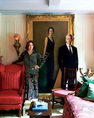 Gloria Vanderbilt in front of a portrait of her mother and with a cardboard cut out of her son Anderson Cooper.
