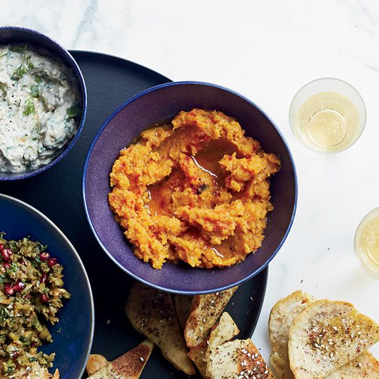 From smoky eggplant to sweet-spicy squash, here are nine terrific, portable dips for a Thanksgiving potluck.