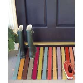 Pallet Door Mat.  Great frugal solution for a door mat.  Decorate for the holidays or use as a shower mat.