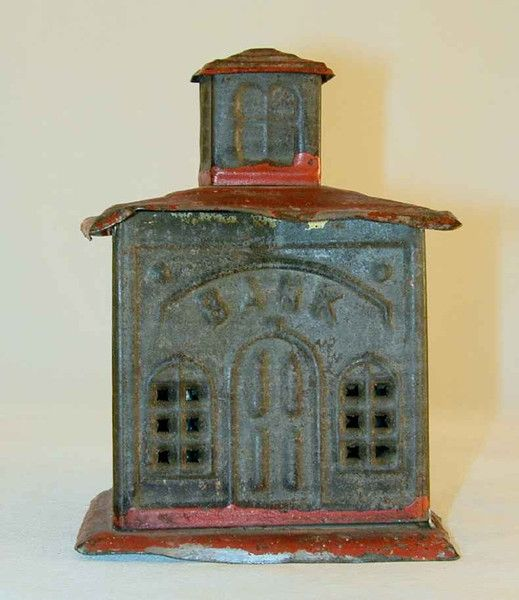 Antique Tin Penny Bank In The Form Of A Bank Building With Red Painted Roof