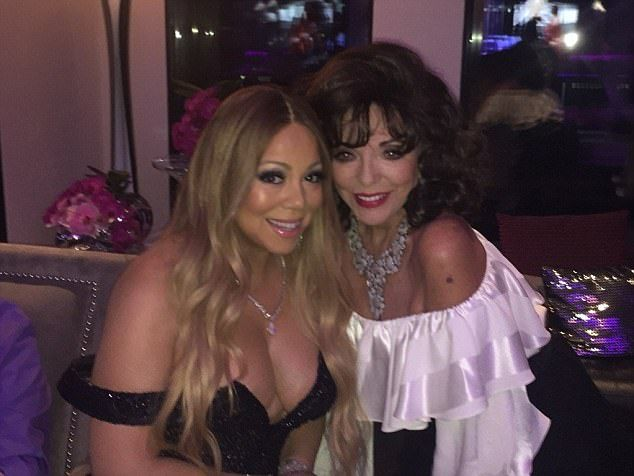 Evergreen Dame Joan Collins posted this snap of herself cosying up to pop star Mariah Care...