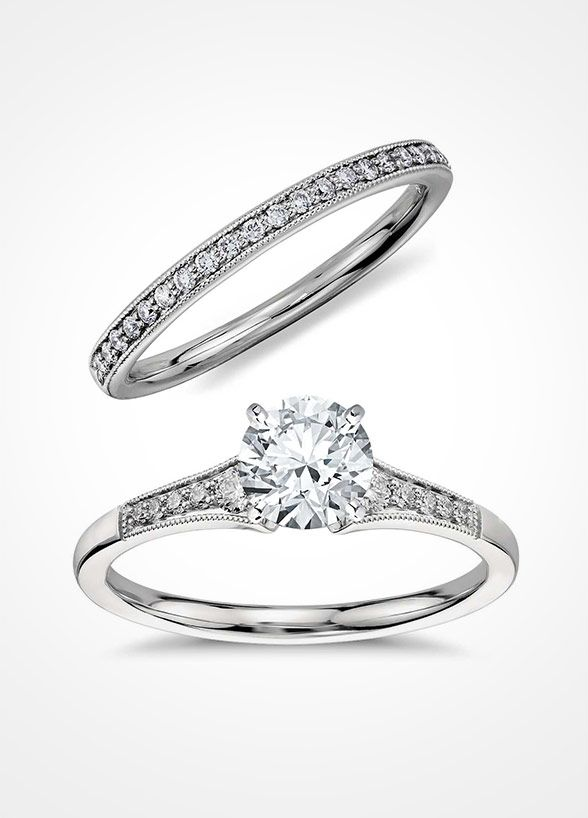 These Delicately Crafted Designs Both Feature Diamonds Along The Top To Create A Fine Line Of Brilliance