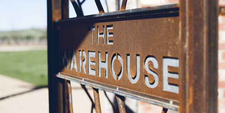 Welcome to The Warehouse #thewarehouse #rustic #sign #gate #wroughtiron #meletos
