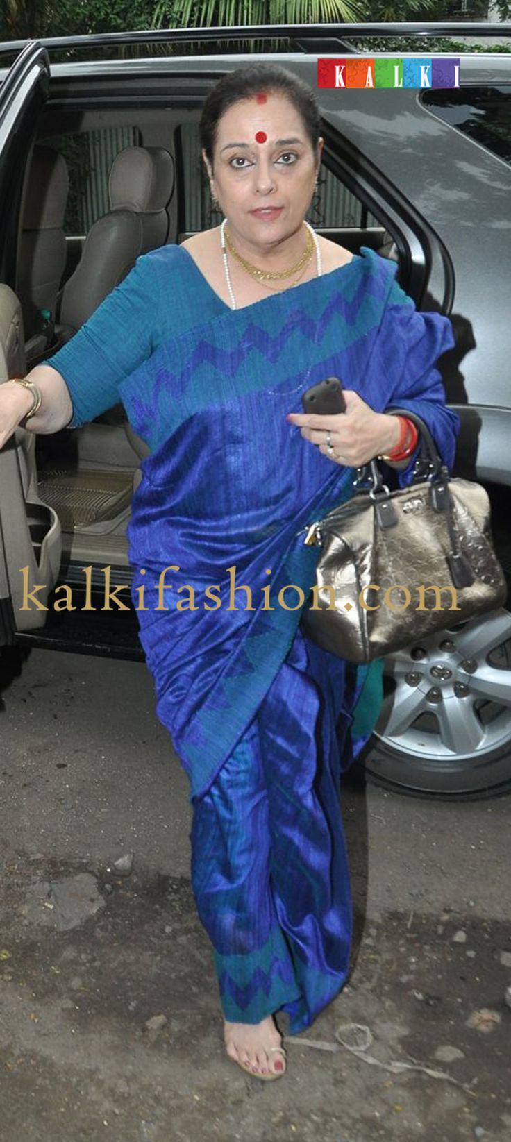 http://www.kalkifashion.com/   Poonam Sinha in blue plain raw silk saree for Ganpati Visarjan at Salman Khan's residence