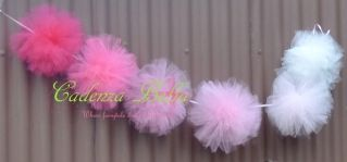 My Tulle pom pom garlands are made from yards of soft fluffy tulle in many many colours of your choice.  These Garlands have many uses, they can be used for room decoration, as wedding decor, decoration for a summer tea party/baby showers/engagement party/any party really. Each Garland comes with 6 tulle puffs. They are sent to you flat & tied in place to the ribbon (which is approximately 1.2m long). They will require you to 'puff them' up on arrival, or when ready to use. Medium…