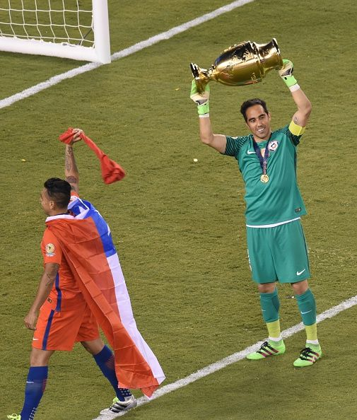 #COPA2016 #COPA100 Chile's goalkeeper Claudio Bravo celebrates with the trophy after winning the Copa America Centenario final by defeating Argentina in the penalty...