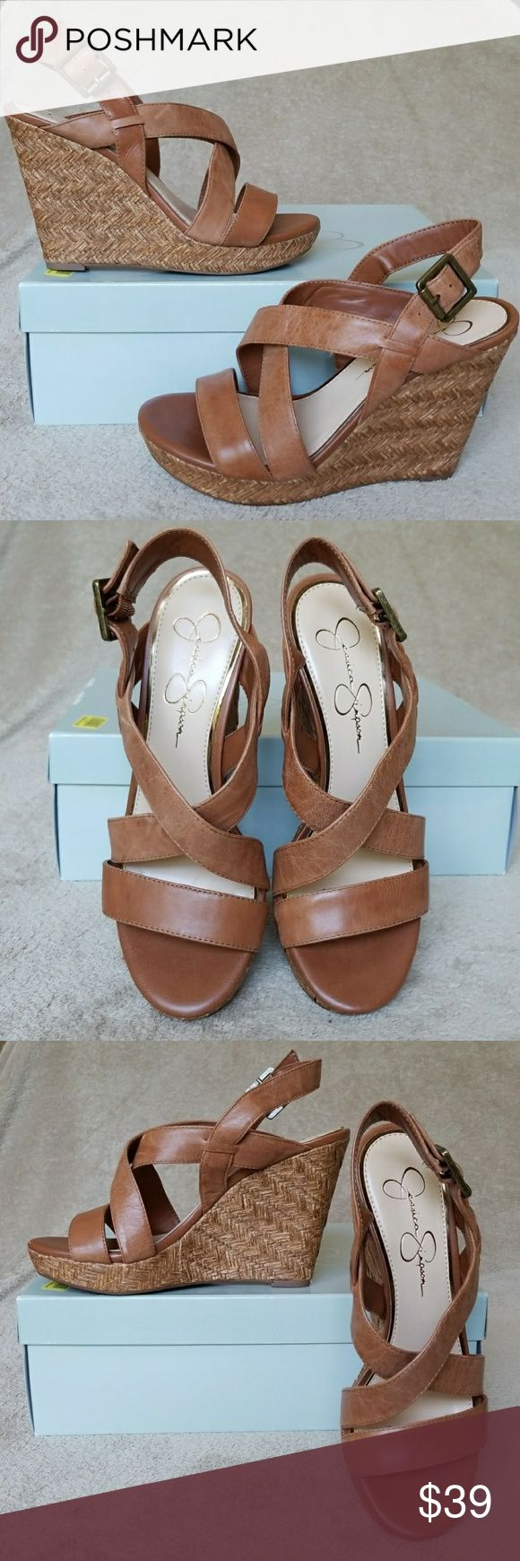 New Jessica Simpson tan strappy wedge sandals New Jessica Simpson woven tan wedge strappy leather sandals. Great and stylish, in a beautiful camel color with woven bottoms that surround the wedge heel that is 4.5in high. New never used still with box.(these are size 8.5, box says 9) Jessica Simpson Shoes Wedges