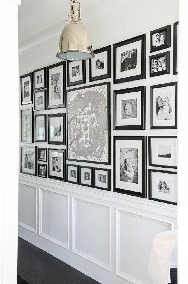 Photo Gallery Wall. Hallway Foyer with Photo Gallery Wall. Black and white Photo Gallery Wall. #PhotoGalleryWall Monika Hibbs.