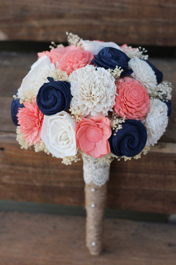 Thank you for looking. I hope to work with you on your floral needs. This listing features a bouquet features shell flowers, roses, mums, carnations and zinnias in English navy, coral and ivory. This bouquet has cream filler and is wrapped in burlap and accented with a lace collar with pearls. Any of these flower colors may be hand dyed in your very special wedding palette colors. The picture above shows a medium size. It measures 25 inches around the whole flower ball. Size is approximate…