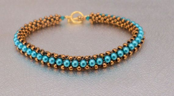 A beadwork bracelet of blue pearls and gold seed beads that is fun an chic. Wear it with a nice dress or a t shirt and jeans. It is one of a kind! It