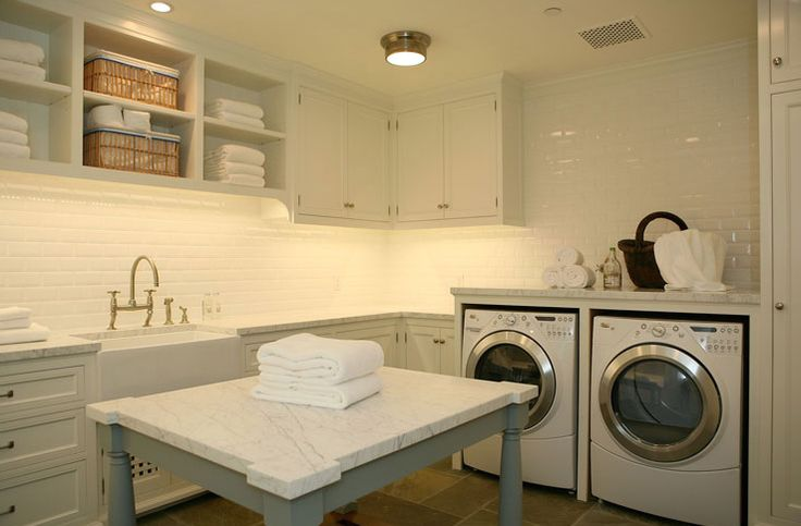 Laundry room, farmhouse sink, island with carra marble top, subway tiles and stone tile floors