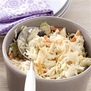 Honey Mustard Coleslaw Recipe -I tinkered around with a family cole slaw recipe until I arrived at this sweet & tangy combination. The packaged shredded cabbage is a real time-saver, and the honey helps the dressing come together faster. An added bonus is there no mess to clean up!