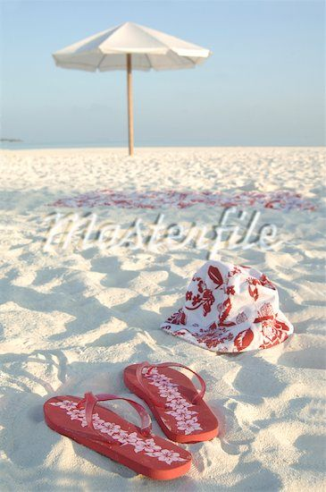 White sands, the perfect red flip flops, adorable beach bag and umbrella....calls for a perfect beach day.