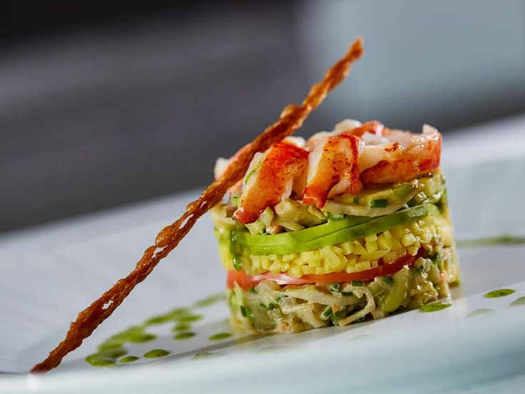 #Lobster, avocado, and mango #Napoleon with citrus vinaigrette by #ARIAFineCatering