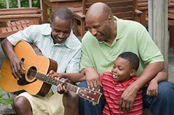 How to Teach Children to Play Guitar  and there's also a great list of beginning songs for kids here: http://guitar.about.com/od/tabchordslyrics/qt/childrens_songs.htm