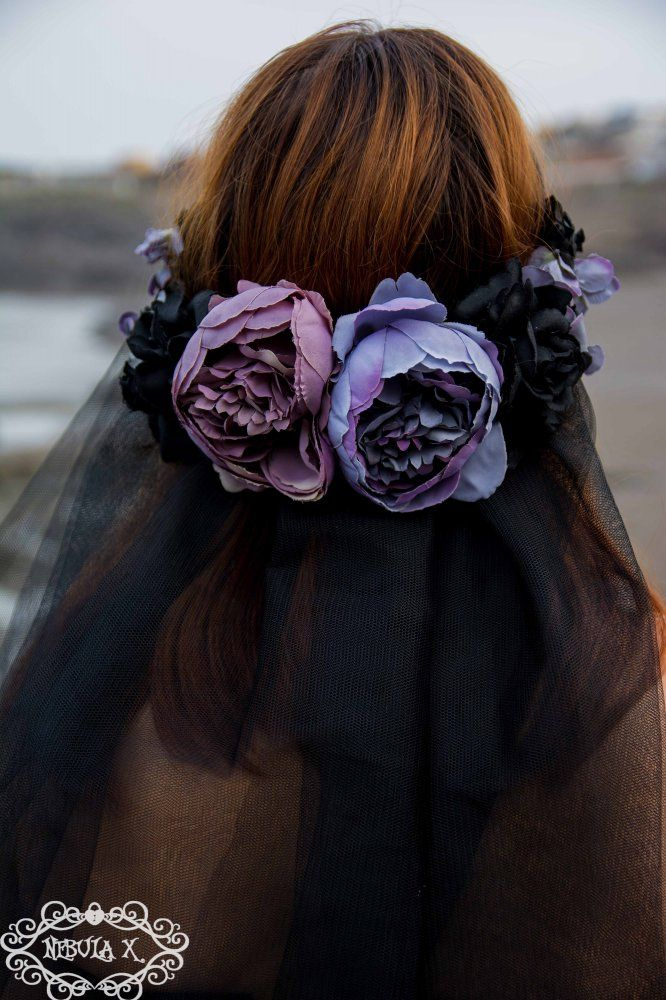 Beautiful dark romantic flower crown! The back and sides are covered with roses and flowers in black and different tones of purple andd lavender of different sizes. Two layers of black tulle veil hang down the back. Black lace crowns the forehead. Slightly inspired by the Corpse Bride. This headpiece has a matching choker.It´s excellent for costumes, photoshoots or for any occasion when you want to look extra special.Lightweight and comfortable to wear, the base is rigid.Nebula X Crafts…