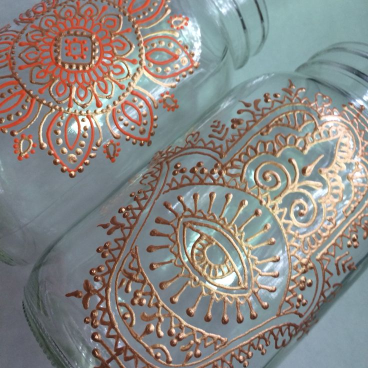 Hamsa and mandala on mason jars