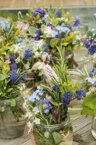 Table centre suggestion. Very full (and quite messy!) jam jars with veronica and lavender.