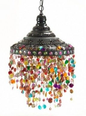 Use an old metal hanging lamp without the glass bottom, drill holes and string glass beads from it to make this rainbow pendant light