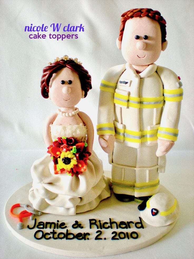 FIREFIGHTER WEDDING CAKE TOPPER.  Custom made wedding figures for the bride and groom in uniforms by www.nicolewclark.com.  All figures are lovingly made by Nicole W Clark . #Firemancaketopper #firefightercaketopper #firefighterweddinggift