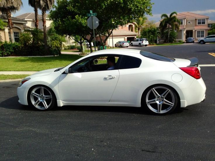 I love this car SO much. I found this on the nissan altima coupe Facebook page. A beautiful white nissan coupe on dope wheels❤!