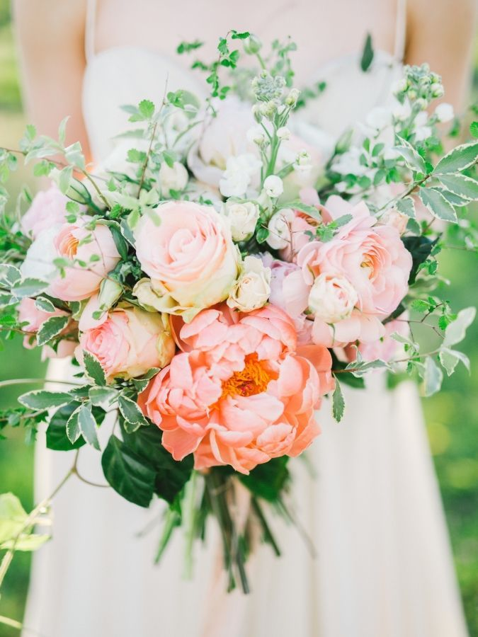 Coral charm peony and rose spring wedding bouquet: http://www.stylemepretty.com/canada-weddings/ontario/lincoln/2017/03/29/spring-inspiration-2/ Photography: Julia Park - http://www.juliapark.ca/