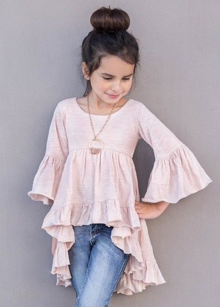 Featuring a ruffled hem and bell sleeves, this dramatic high low top is the perfect bohemian addition to any wardrobe. We love this top paired with leggings and flats!