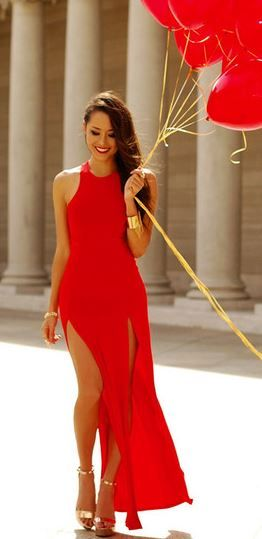 Sexy double slit red dress . love the gold cuff too.
